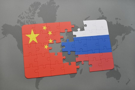 against: puzzle with the national flag of china and russia on a world map background. 3D illustration Stock Photo