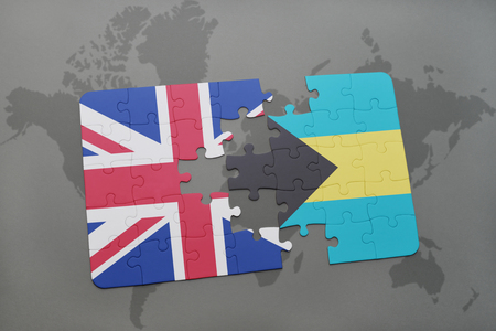 bahamas map: puzzle with the national flag of great britain and bahamas on a world map background.