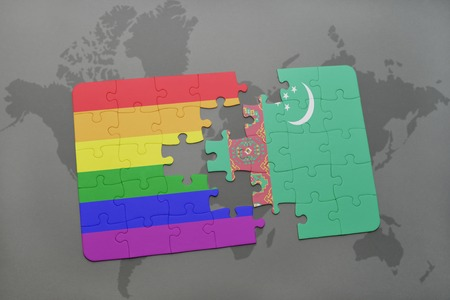 turkmenistan: puzzle with the national flag of turkmenistan and gay rainbow flag on a world map background. 3D illustration Stock Photo