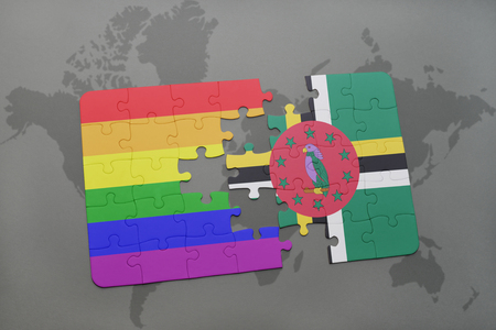 homosexual partners: puzzle with the national flag of dominica and gay rainbow flag on a world map background. 3D illustration Stock Photo
