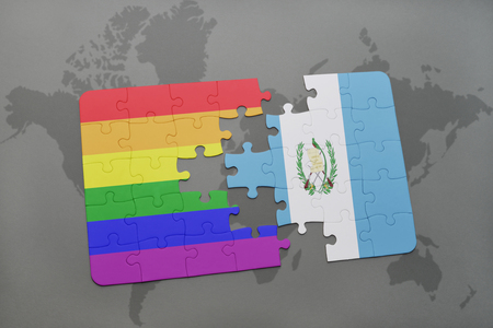 guatemalan: puzzle with the national flag of guatemala and gay rainbow flag on a world map background. 3D illustration Stock Photo