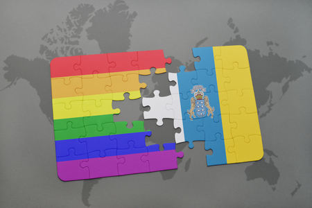 canary: puzzle with the national flag of canary islands and gay rainbow flag on a world map background. 3D illustration Stock Photo