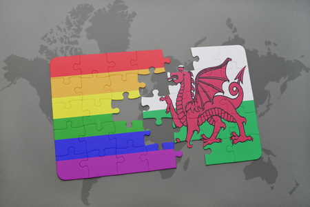 welsh flag: puzzle with the national flag of wales and gay rainbow flag on a world map background. 3D illustration