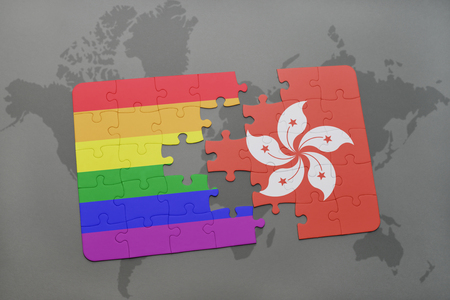 puzzle with the national flag of hong kong and gay rainbow flag on a world map background. 3D illustration