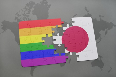 middle east crisis: puzzle with the national flag of japan and gay rainbow flag on a world map background. 3D illustration