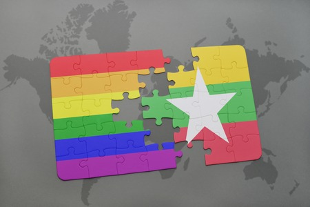 middle east peace: puzzle with the national flag of myanmar and gay rainbow flag on a world map background. 3D illustration Stock Photo