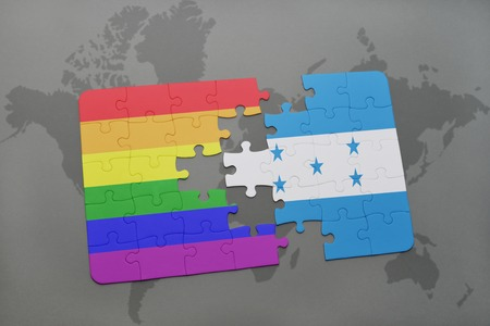 homosexual partners: puzzle with the national flag of honduras and gay rainbow flag on a world map background. 3D illustration