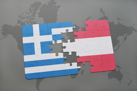 separatism: puzzle with the national flag of greece and austria on a world map background. 3D illustration