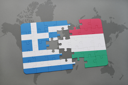 separatism: puzzle with the national flag of greece and hungary on a world map background. 3D illustration