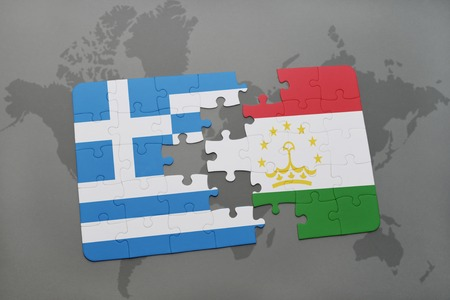 separatism: puzzle with the national flag of greece and tajikistan on a world map background. 3D illustration