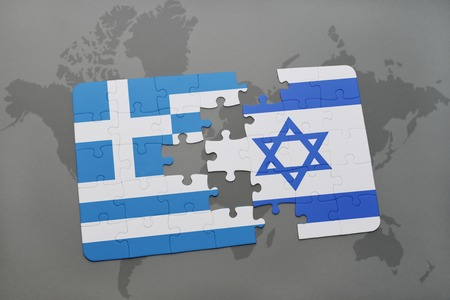 middle east crisis: puzzle with the national flag of greece and israel on a world map background. 3D illustration Stock Photo