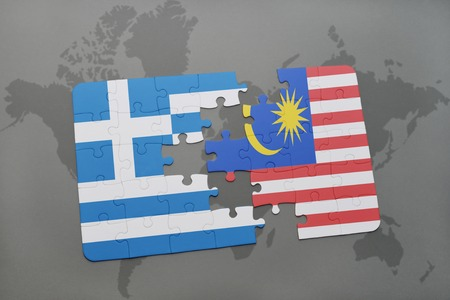 separatism: puzzle with the national flag of greece and malaysia on a world map background. 3D illustration Stock Photo