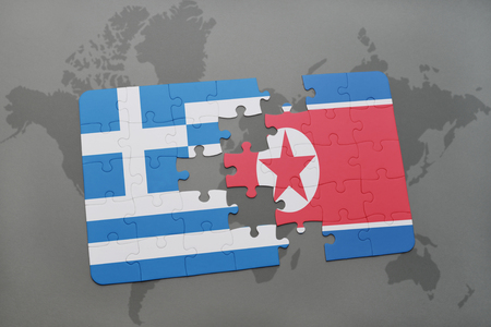 separatism: puzzle with the national flag of greece and north korea on a world map background. 3D illustration Stock Photo