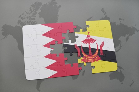 map of brunei: puzzle with the national flag of bahrain and brunei on a world map background. 3D illustration