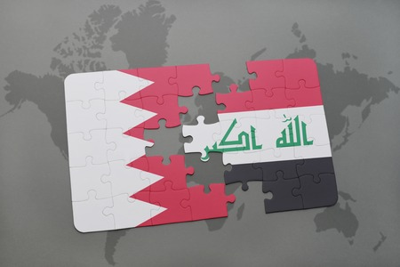 iraq conflict: puzzle with the national flag of bahrain and iraq on a world map background. 3D illustration Stock Photo