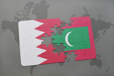 maldives island: puzzle with the national flag of bahrain and maldives on a world map background. 3D illustration