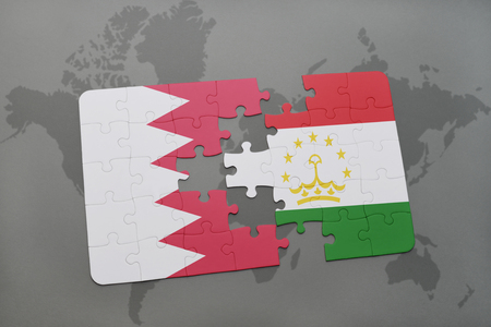 economy of tajikistan: puzzle with the national flag of bahrain and tajikistan on a world map background. 3D illustration