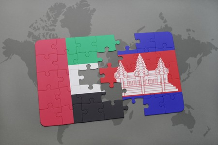 cambodian: puzzle with the national flag of united arab emirates and cambodia on a world map background. 3D illustration