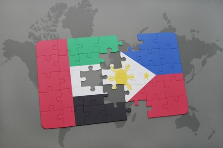 middle east crisis: puzzle with the national flag of united arab emirates and philippines on a world map background. 3D illustration Stock Photo