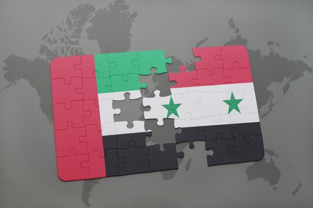 business partner: puzzle with the national flag of united arab emirates and syria on a world map background. 3D illustration Stock Photo