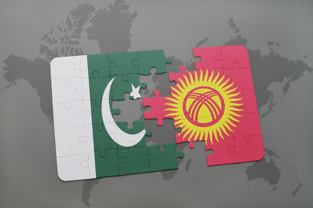islamabad: puzzle with the national flag of pakistan and kyrgyzstan on a world map background. 3D illustration Stock Photo