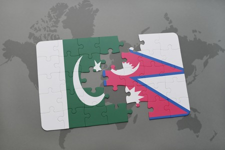 middle east crisis: puzzle with the national flag of pakistan and nepal on a world map background. 3D illustration Stock Photo