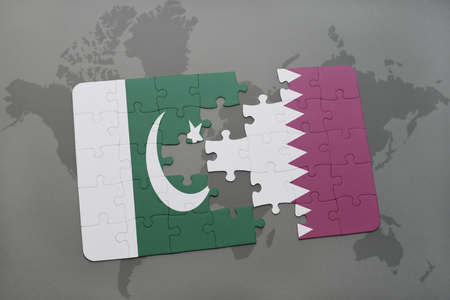 islamabad: puzzle with the national flag of pakistan and qatar on a world map background. 3D illustration Stock Photo