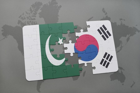islamabad: puzzle with the national flag of pakistan and south korea on a world map background. 3D illustration