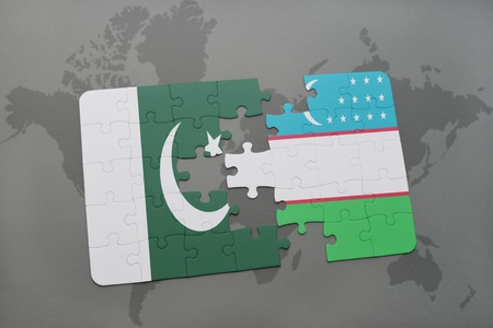 islamabad: puzzle with the national flag of pakistan and uzbekistan on a world map background. 3D illustration