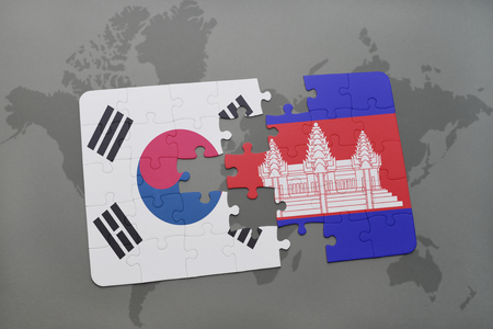 cambodian flag: puzzle with the national flag of south korea and cambodia on a world map background. 3D illustration
