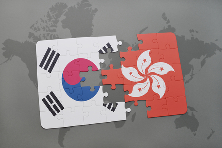 world flag: puzzle with the national flag of south korea and hong kong on a world map background. 3D illustration