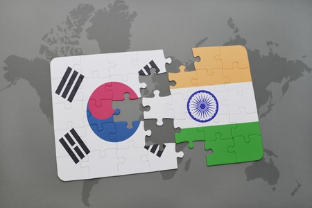 south india: puzzle with the national flag of south korea and india on a world map background. 3D illustration