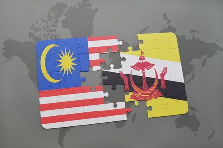 map of brunei: puzzle with the national flag of malaysia and brunei on a world map background. 3D illustration