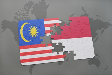 middle east crisis: puzzle with the national flag of malaysia and indonesia on a world map background. 3D illustration