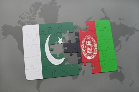 islamabad: puzzle with the national flag of pakistan and afghanistan on a world map background. 3D illustration Stock Photo