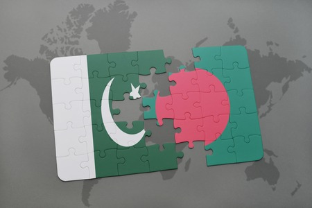 middle east crisis: puzzle with the national flag of pakistan and bangladesh on a world map background. 3D illustration Stock Photo
