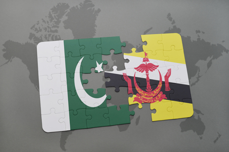islamabad: puzzle with the national flag of pakistan and brunei on a world map background. 3D illustration