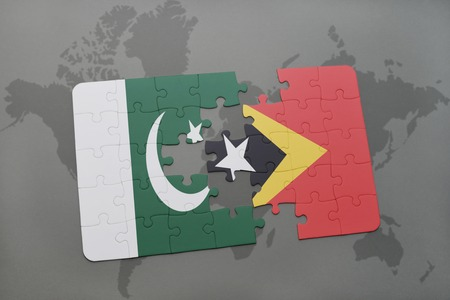 middle east crisis: puzzle with the national flag of pakistan and east timor on a world map background. 3D illustration