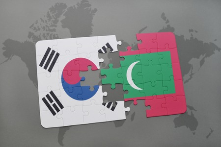 maldives island: puzzle with the national flag of south korea and maldives on a world map background. 3D illustration