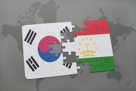 middle east crisis: puzzle with the national flag of south korea and tajikistan on a world map background. 3D illustration