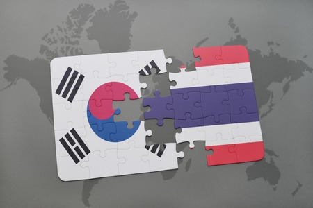 rendering: puzzle with the national flag of south korea and thailand on a world map background. 3D illustration