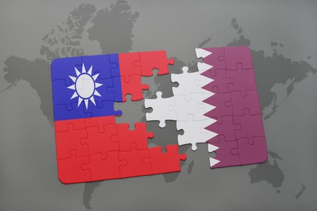 middle east crisis: puzzle with the national flag of taiwan and qatar on a world map background. 3D illustration Stock Photo