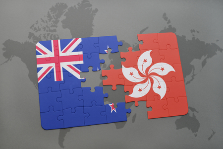 middle east crisis: puzzle with the national flag of new zealand and hong kong on a world map background. 3D illustration Stock Photo