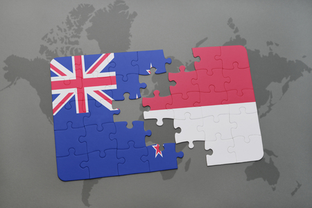 separatism: puzzle with the national flag of new zealand and indonesia on a world map background. 3D illustration