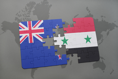 separatism: puzzle with the national flag of new zealand and syria on a world map background. 3D illustration Stock Photo