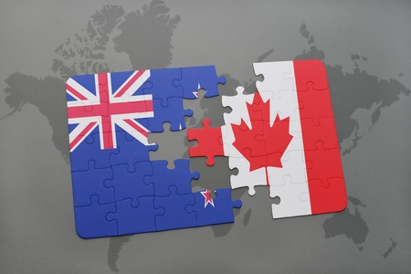 puzzle with the national flag of new zealand and canada on a world map background. 3D illustration