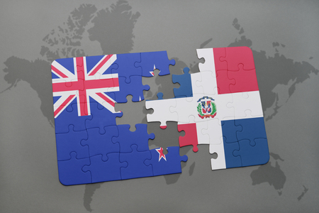 separatism: puzzle with the national flag of new zealand and dominican republic on a world map background. 3D illustration Stock Photo