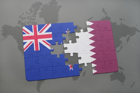 separatism: puzzle with the national flag of new zealand and qatar on a world map background. 3D illustration Stock Photo