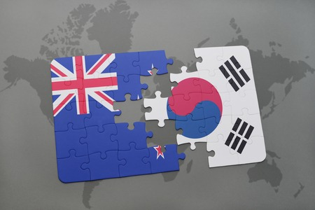 separatism: puzzle with the national flag of new zealand and south korea on a world map background. 3D illustration