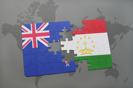 middle east crisis: puzzle with the national flag of new zealand and tajikistan on a world map background. 3D illustration Stock Photo